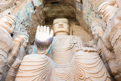 甘肃,中国- 2015年4月09日:在Tiantishan洞穴的Budda雕象 库存照片