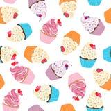甜奶油色纹理的杯形蛋糕无缝的样式 库存图片
