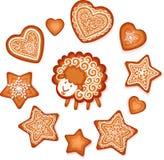 甜姜饼星、心脏和绵羊 免版税库存照片