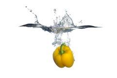 甜椒飞溅黄色 库存图片