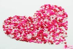 甜点白色背景的标志心脏 顶视图 库存图片