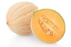 甜瓜瓜和一半在白色 库存图片