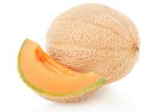 甜瓜瓜和切片在白色 库存图片