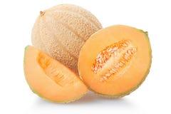 甜瓜瓜部分和切片在白色 库存照片