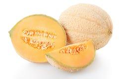 甜瓜瓜部分和切片在白色 免版税库存图片