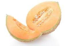 甜瓜瓜部分和切片在白色 免版税库存照片