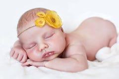 甜睡眠愉快的婴孩 库存照片