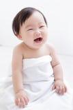 甜逗人喜爱的婴孩微笑 免版税库存图片