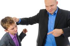 生他的惩罚严格的儿子 库存图片