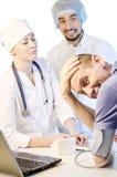 医生和患者小组画象  免版税库存照片