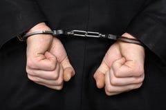 生意人佩带的手铐 免版税库存照片