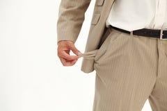 生意人倒空他的口袋拉 免版税图库摄影