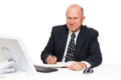 生意人前辈面带笑容 免版税库存图片