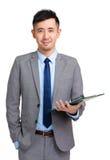 生意人剪贴板藏品信息查出的被采取的白色 免版税库存图片
