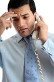 生意人压下了强调的人电话 免版税图库摄影