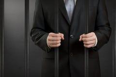 生意人在监狱 免版税库存照片