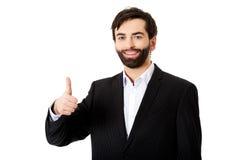 生意人姿态愉快的赞许 免版税库存照片