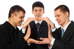 生意人安置掌上型计算机三个年轻人 免版税库存照片