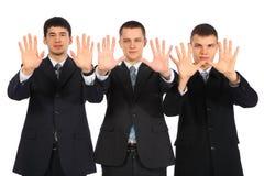 生意人开张掌上型计算机显示三年轻&# 免版税库存图片