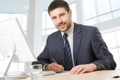 生意人愉快的年轻人 免版税库存图片
