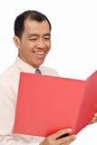 生意人愉快的读的报表 库存照片