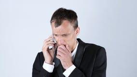 生意人愤怒的电话 免版税库存图片