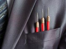 生意人投掷口袋红色诉讼三 免版税图库摄影