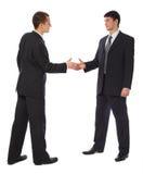 生意人招呼二个年轻人 免版税图库摄影