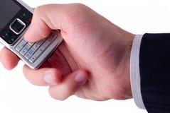 生意人拿着移动电话 免版税库存图片
