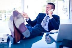 生意人服务台他的工作 免版税库存照片
