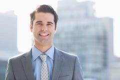 生意人照相机微笑 免版税库存图片