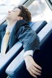 生意人疲乏的年轻人 免版税库存照片