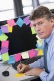 生意人监控程序注意办公室 免版税库存照片