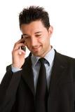 生意人移动电话告诉 免版税库存照片