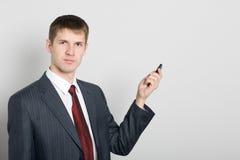 生意人移动电话指向您 免版税库存照片