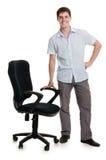 生意人突出扶手椅子 免版税图库摄影