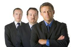 生意人编组看起来严厉 免版税库存照片