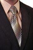 生意人脱下衣服 免版税库存图片