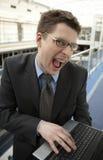 生意人膝上型计算机办公室微笑空间&# 免版税库存照片