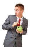 生意人节约金钱年轻人 免版税库存照片