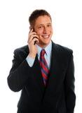 生意人英俊的巨大的电话微笑 免版税图库摄影