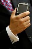 生意人计算的移动电话 免版税库存照片