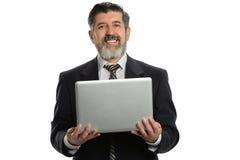 生意人讲西班牙语的美国人膝上型计&# 免版税库存图片