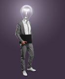 生意人顶头闪亮指示膝上型计算机 库存图片