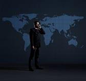 生意人移动电话联系 与警察的黑背景 图库摄影