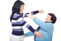 生成拥抱准备给二名妇女 免版税库存图片