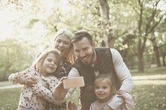生拍家庭的自已照片本质上 库存图片