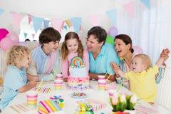 生日开玩笑当事人 与蛋糕的家庭庆祝 图库摄影