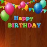 生日快乐与气球的贺卡在木背景 免版税库存照片
