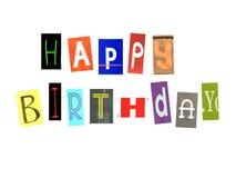 生日快乐词由报纸信件做成 图库摄影